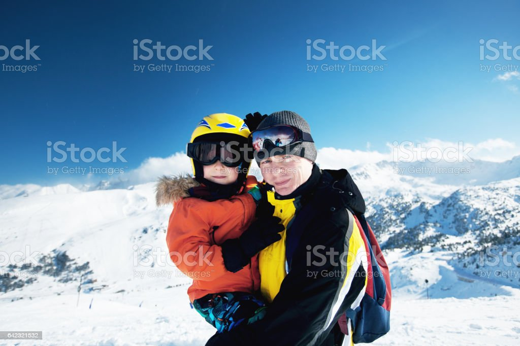 Happy family enjoying winter vacations in mountains stock photo