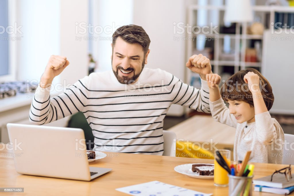 Happy family expressing victory stock photo