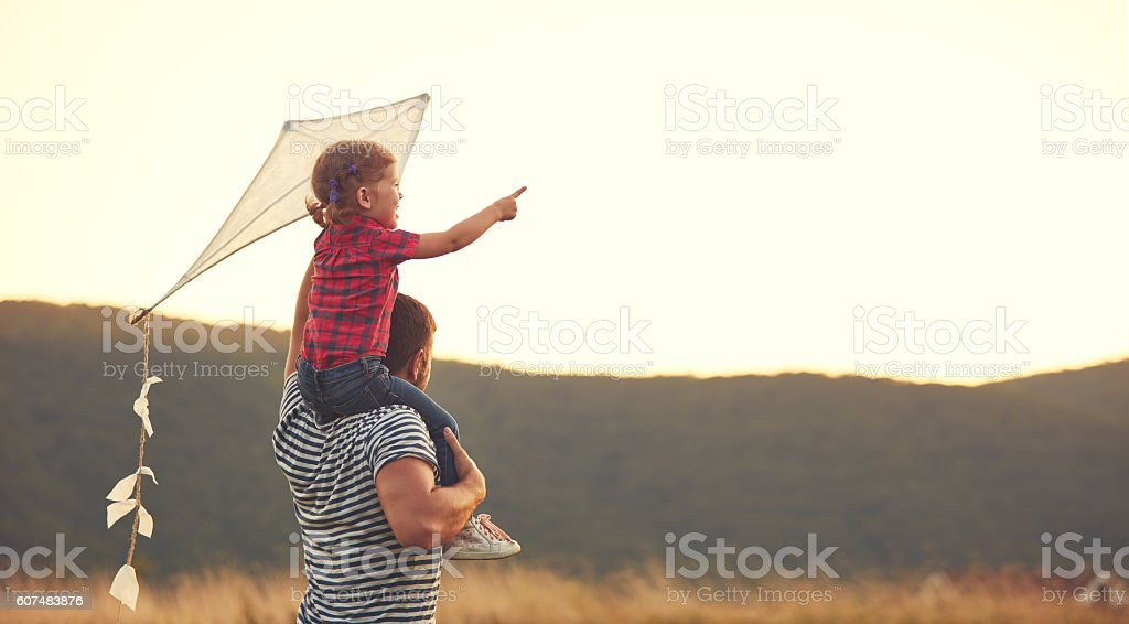 happy family father and child on meadow with a kite stock photo