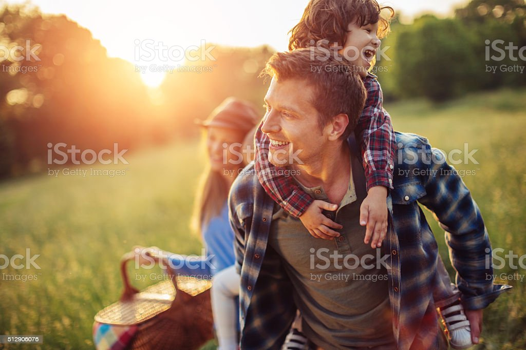 Happy family going for picnic royalty-free stock photo