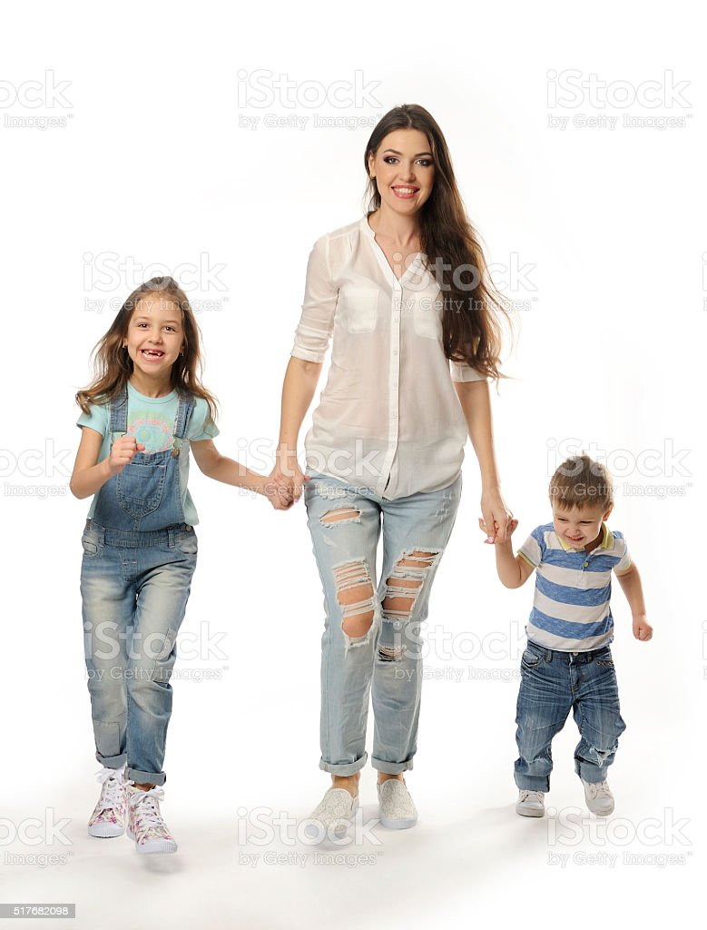 Happy family going, mom, good mood, together, holding hands. stock photo