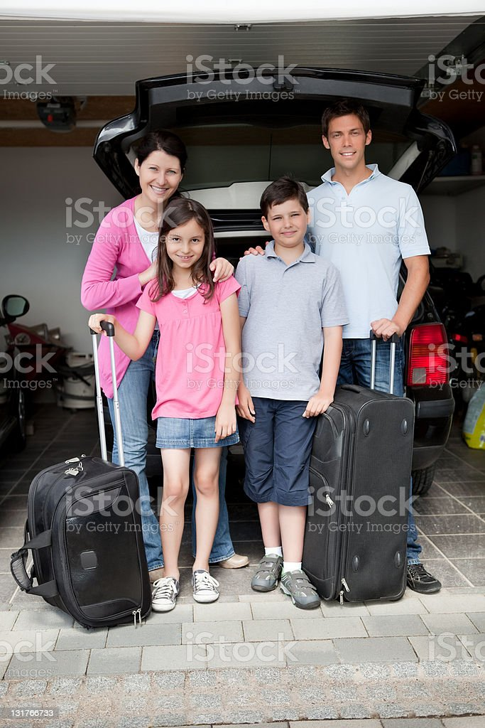 Happy family going on holiday stock photo