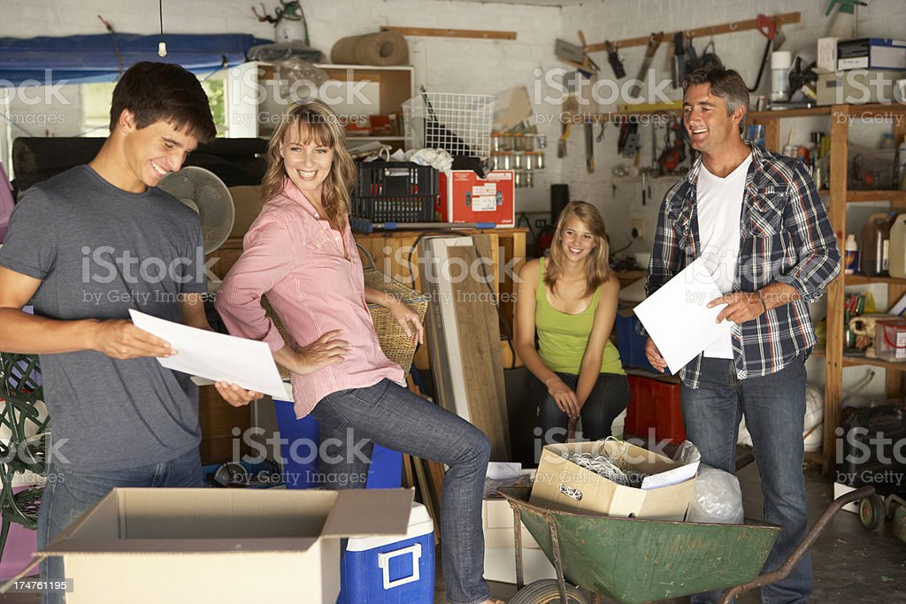 A happy family having a garage sale stock photo