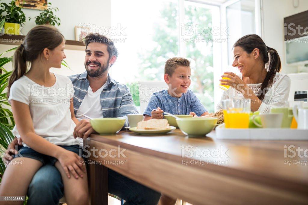 Happy family having breakfast royalty-free stock photo