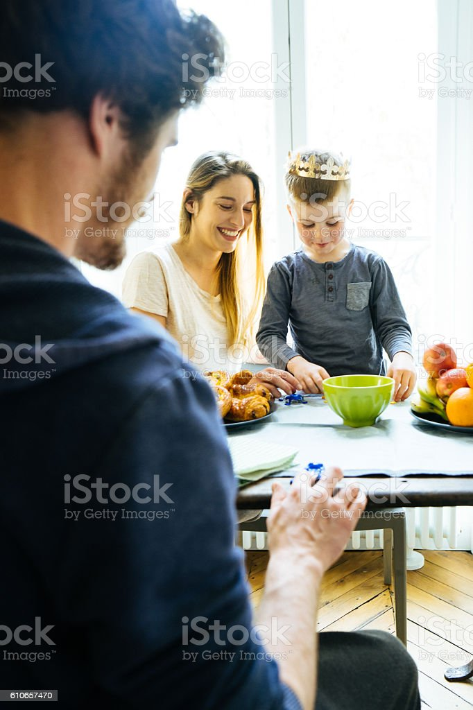 Happy Family Having Breakfast Together At Home And Playing stock photo
