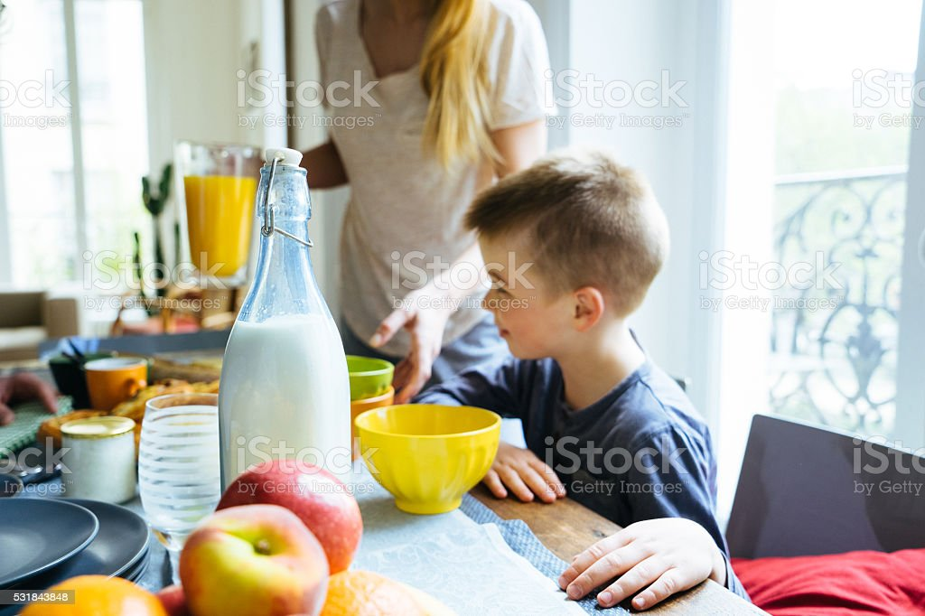Happy Family Having Breakfast Together At Home stock photo