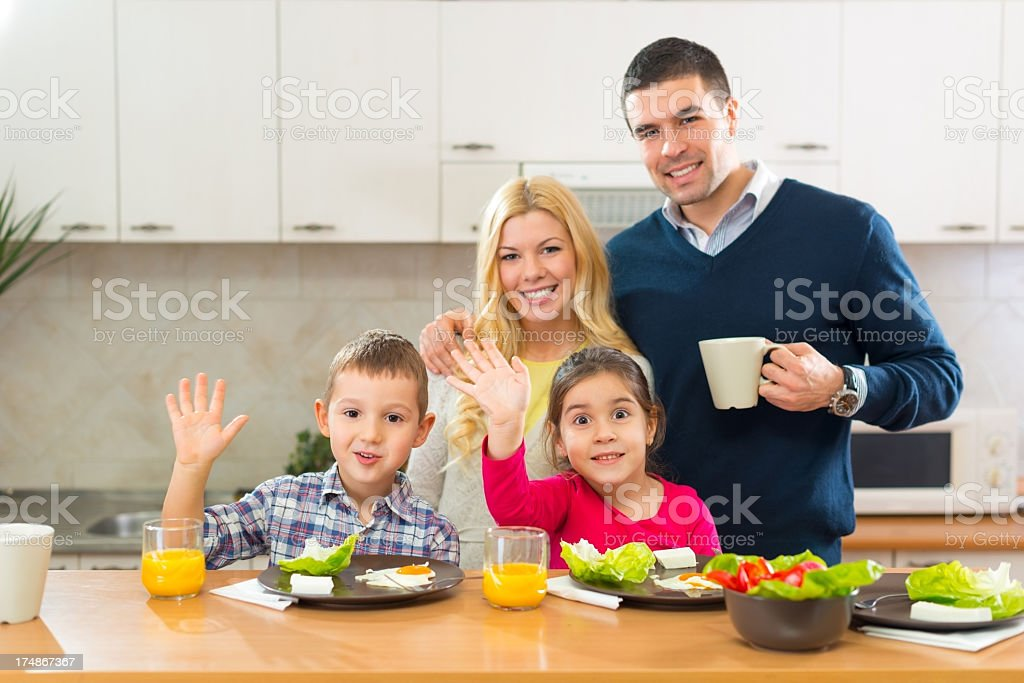 Happy family having breakfast together in the kitchen royalty-free stock photo