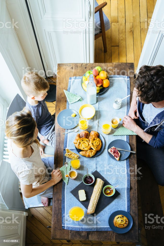 Happy Family Having Breakfast Together Overhead View stock photo