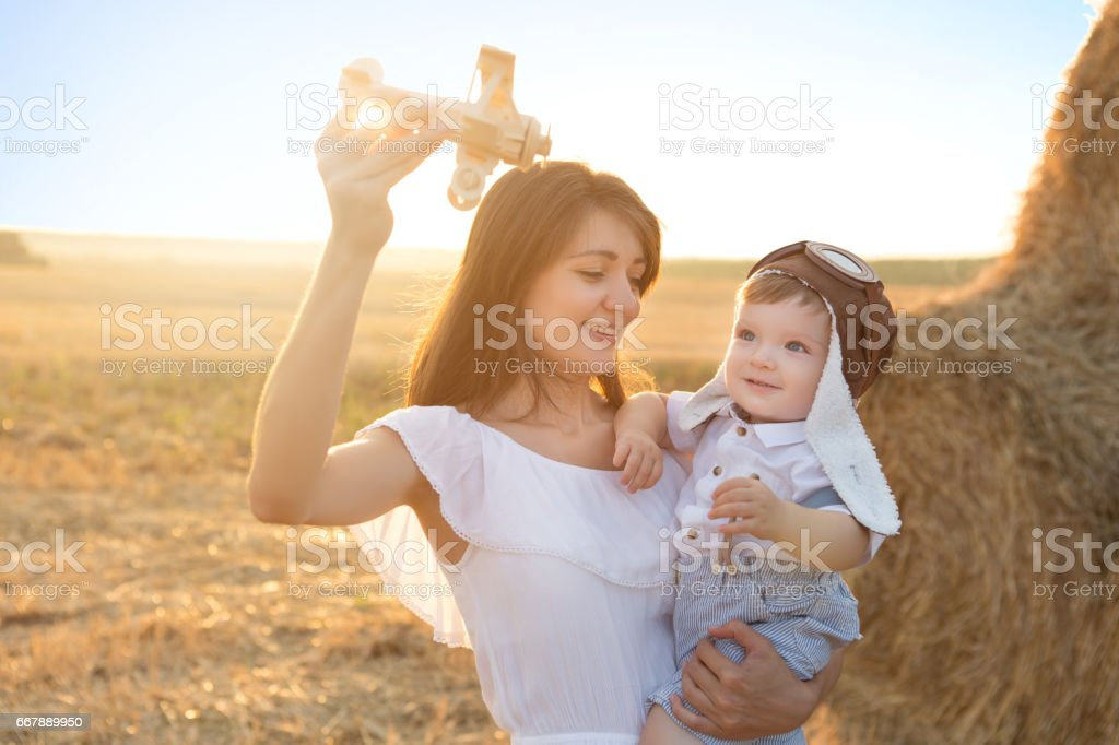 Happy family having fun. Happy mother and her little son in the field. Outdoor. stock photo