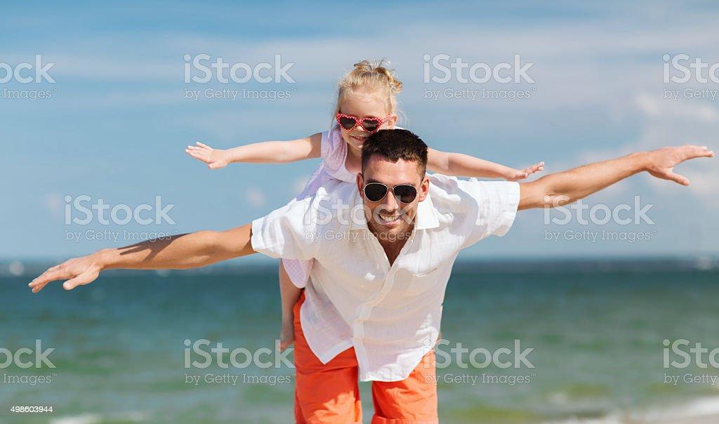 happy family having fun on summer beach stock photo