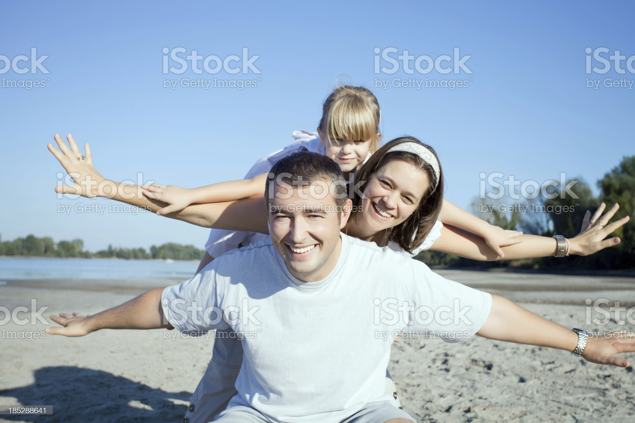Happy family having fun on the beach. royalty-free stock photo