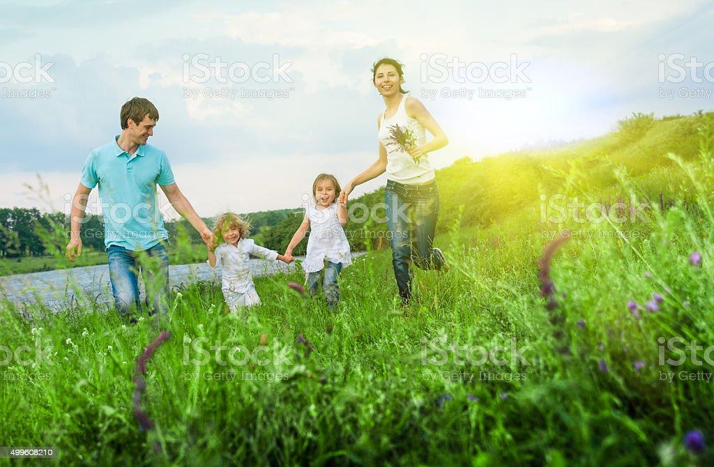 happy family having fun outdoors stock photo