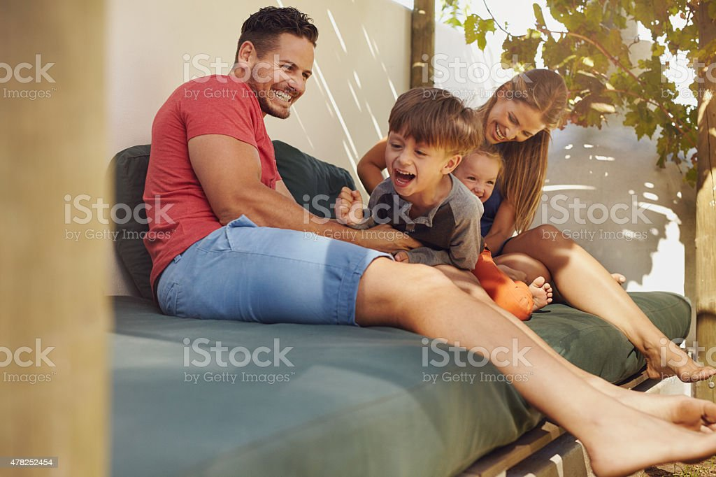 Happy family having fun together in the backyard stock photo