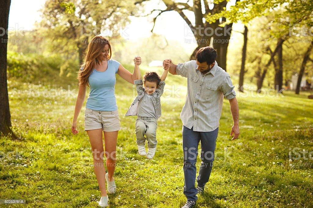 Happy family heaving fun in the park stock photo