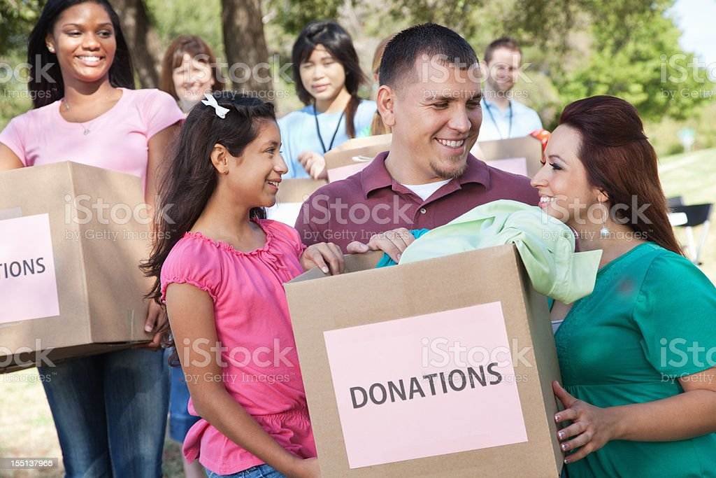 Happy family holding donations box at a donation center royalty-free stock photo