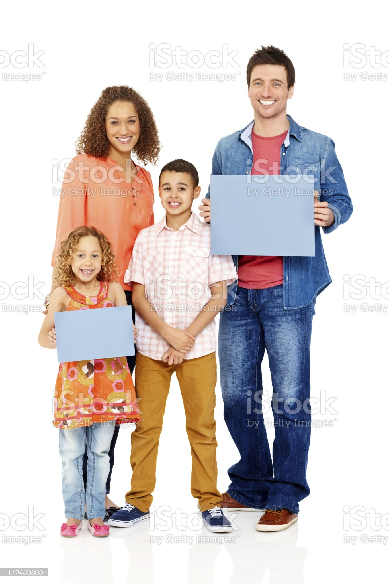 Happy family holding empty billboards over white royalty-free stock photo
