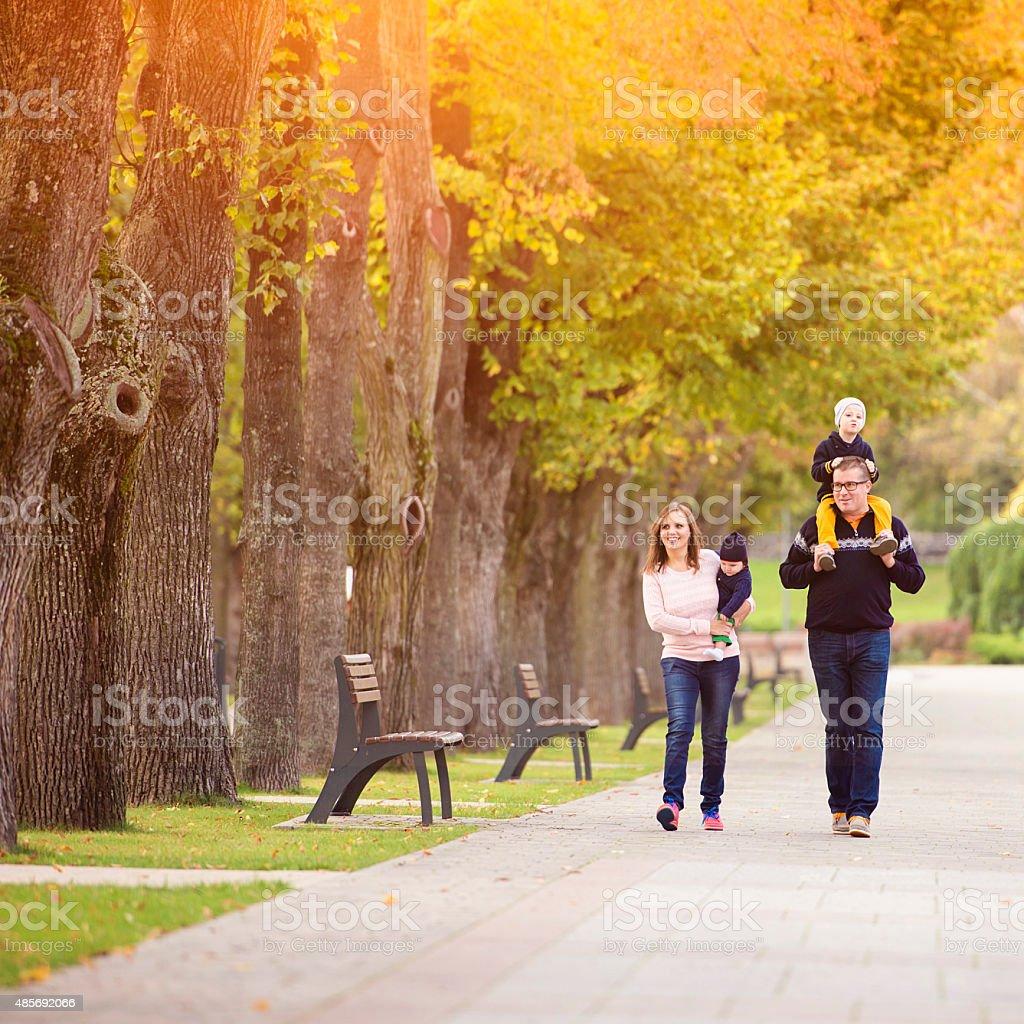 Happy family in a city park stock photo