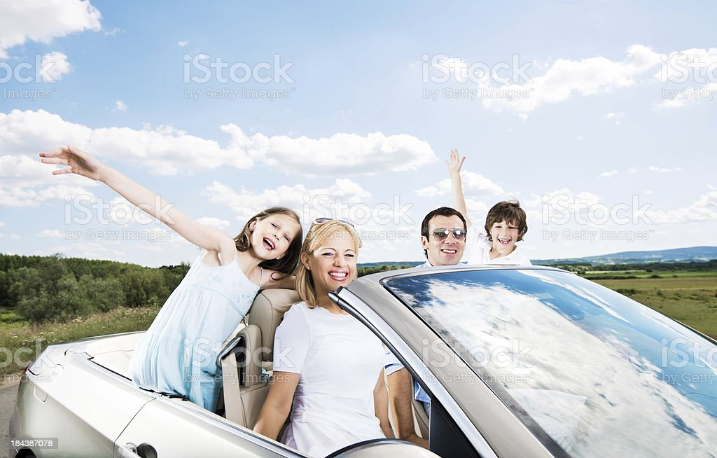 Happy family in a convertible car. royalty-free stock photo