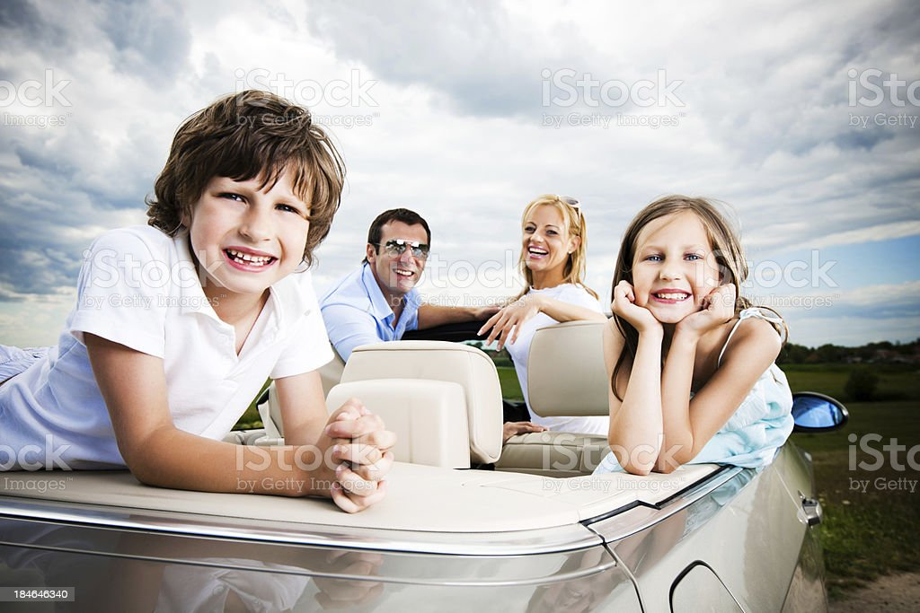 Happy family in a convertible car royalty-free stock photo