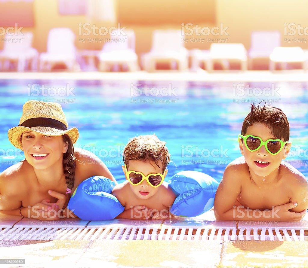Happy family in aquapark stock photo