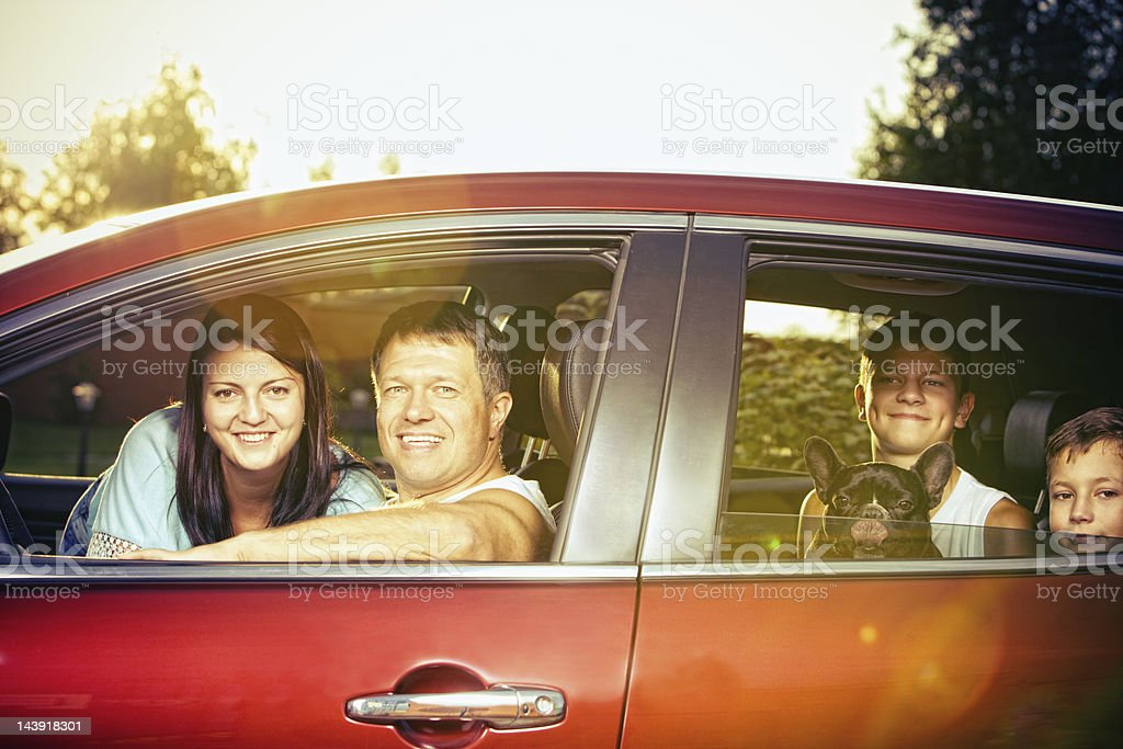 Happy Family in car ready for travel stock photo