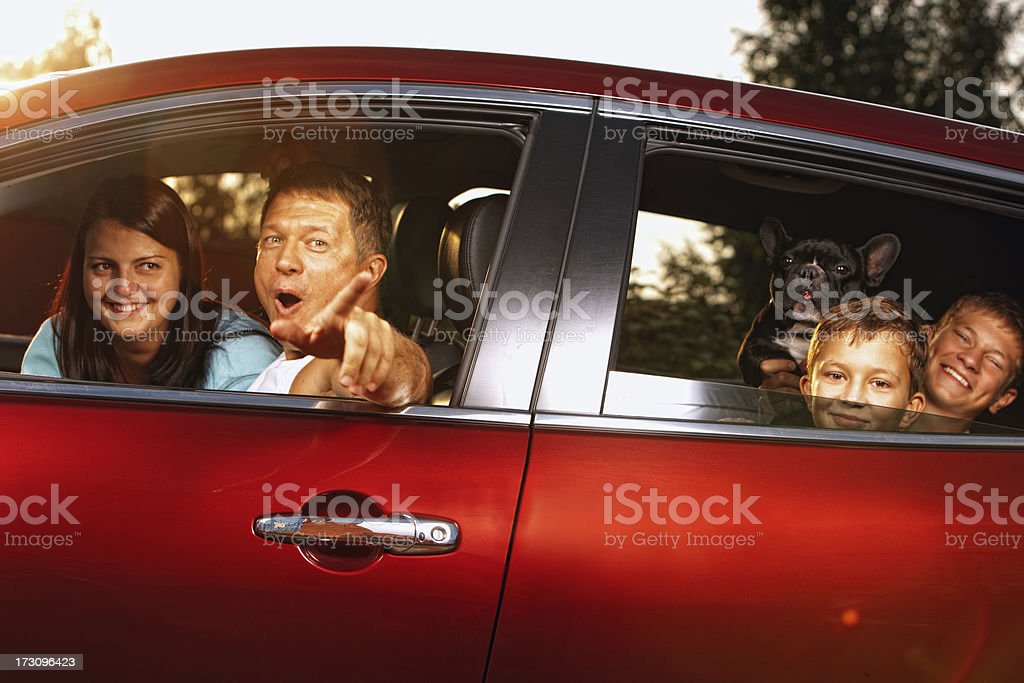Happy Family in car ready for travel royalty-free stock photo