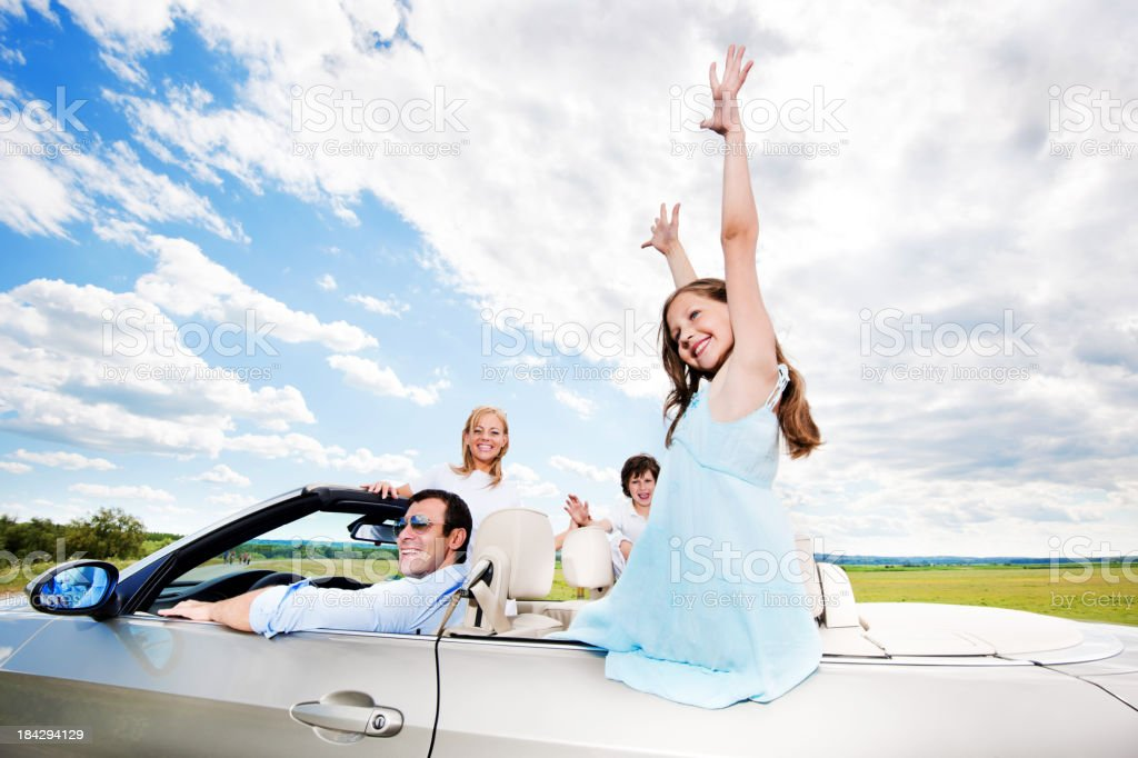 Happy family in convertible car. royalty-free stock photo