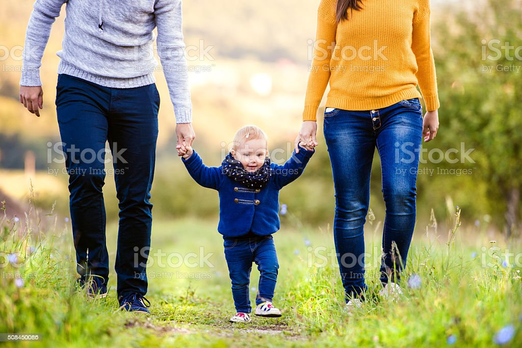 Happy family in nature stock photo