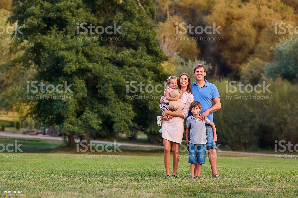 Happy family in  park summer, autumn. Portrait of  father stock photo