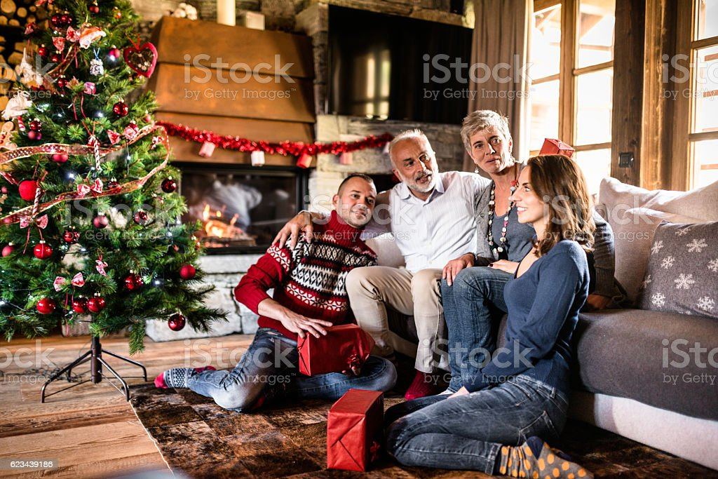 happy family in the living room for christmas stock photo