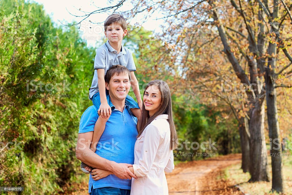 Happy family in the park summer, autumn. Portrait father, stock photo