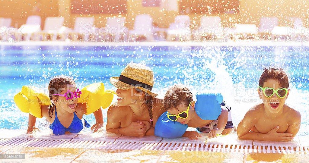 Happy family in the pool stock photo