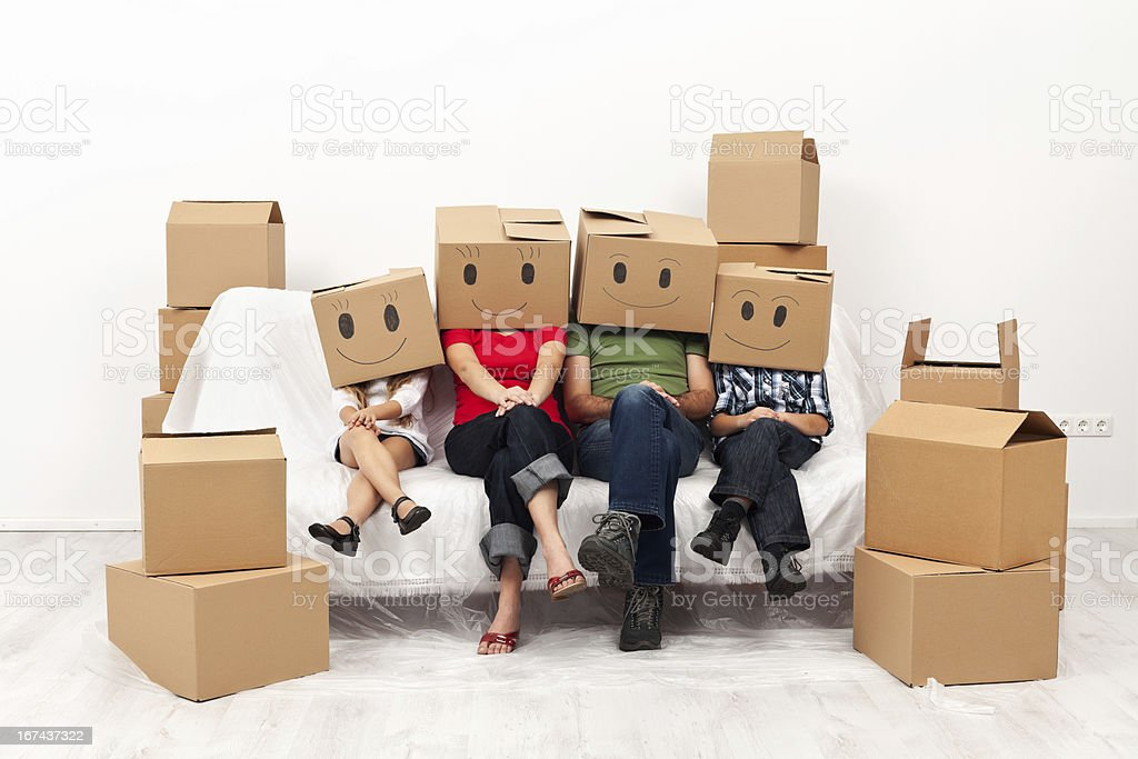 Happy family in their new home concept royalty-free stock photo