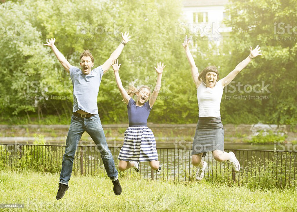 Happy family jumping royalty-free stock photo