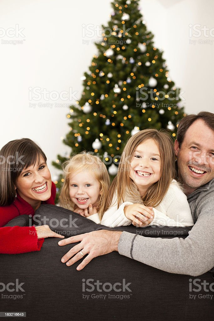 Happy Family Laughing Together at Home with Christmas Tree royalty-free stock photo