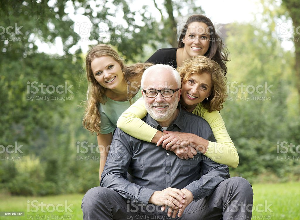 Happy family laughing together outdoors royalty-free stock photo
