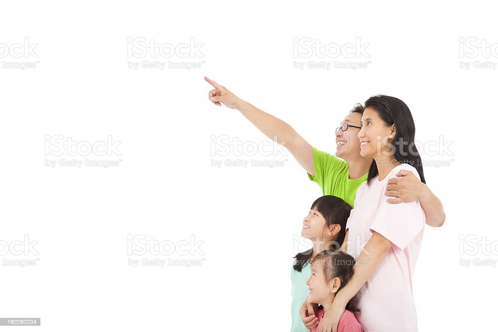 Happy family looking and pointing royalty-free stock photo