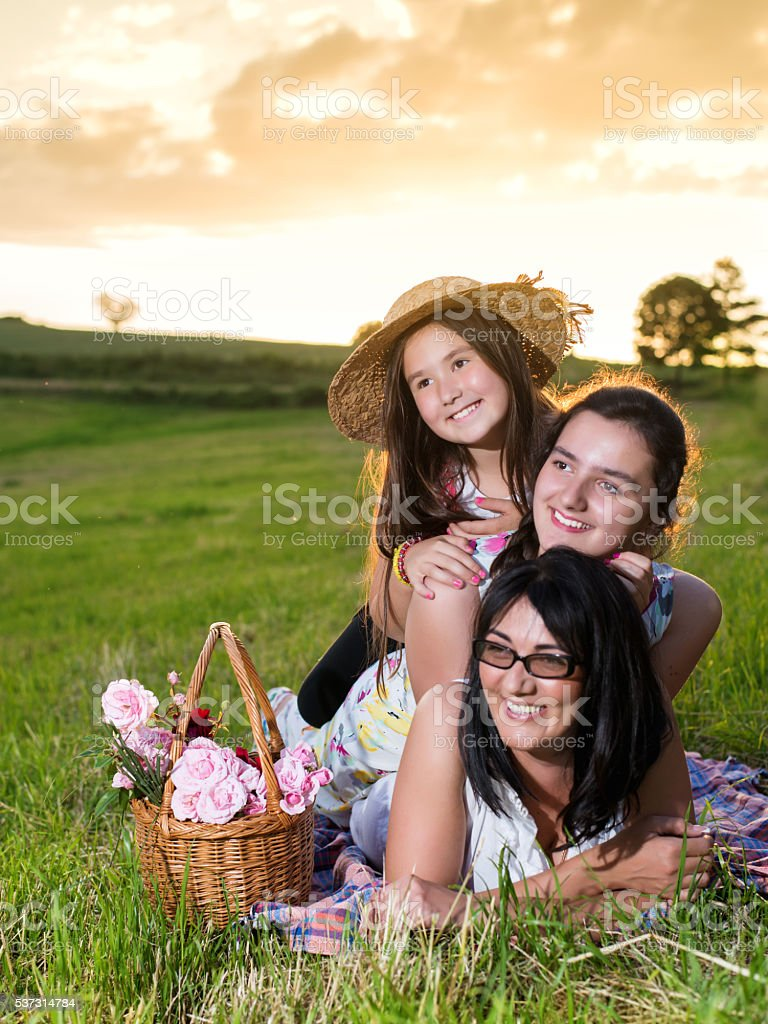 Happy family lying on a pile in nature stock photo