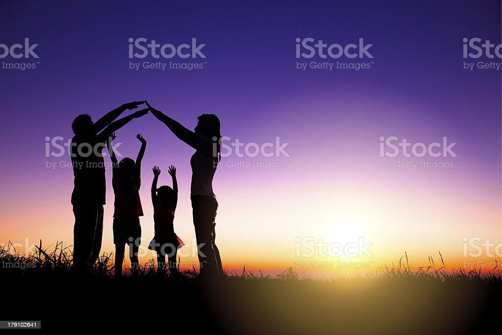 happy family making home sign on the hill stock photo