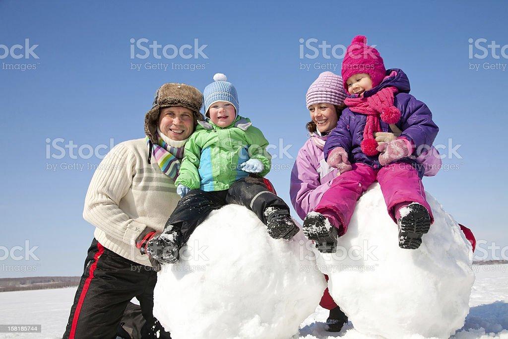 Happy family making snowman royalty-free stock photo
