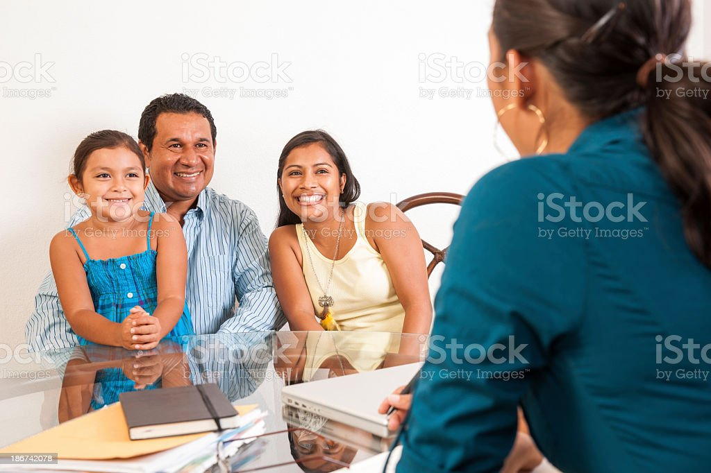Happy family meeting with a professional person stock photo