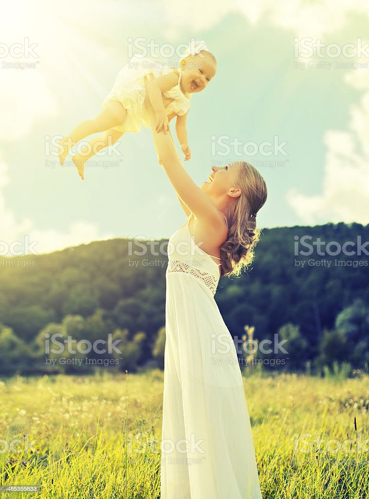 happy family  mother and baby daughter play on nature royalty-free stock photo