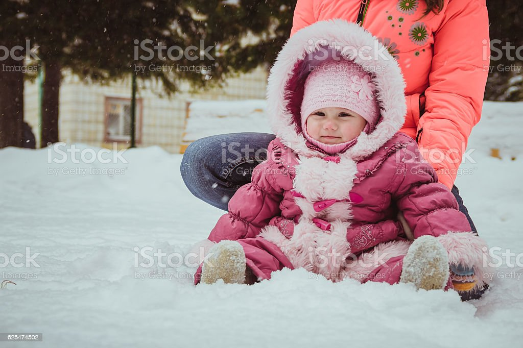 happy family mother and baby girl daughter in winter outdoors stock photo