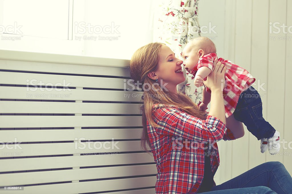happy family mother and baby playing at home stock photo