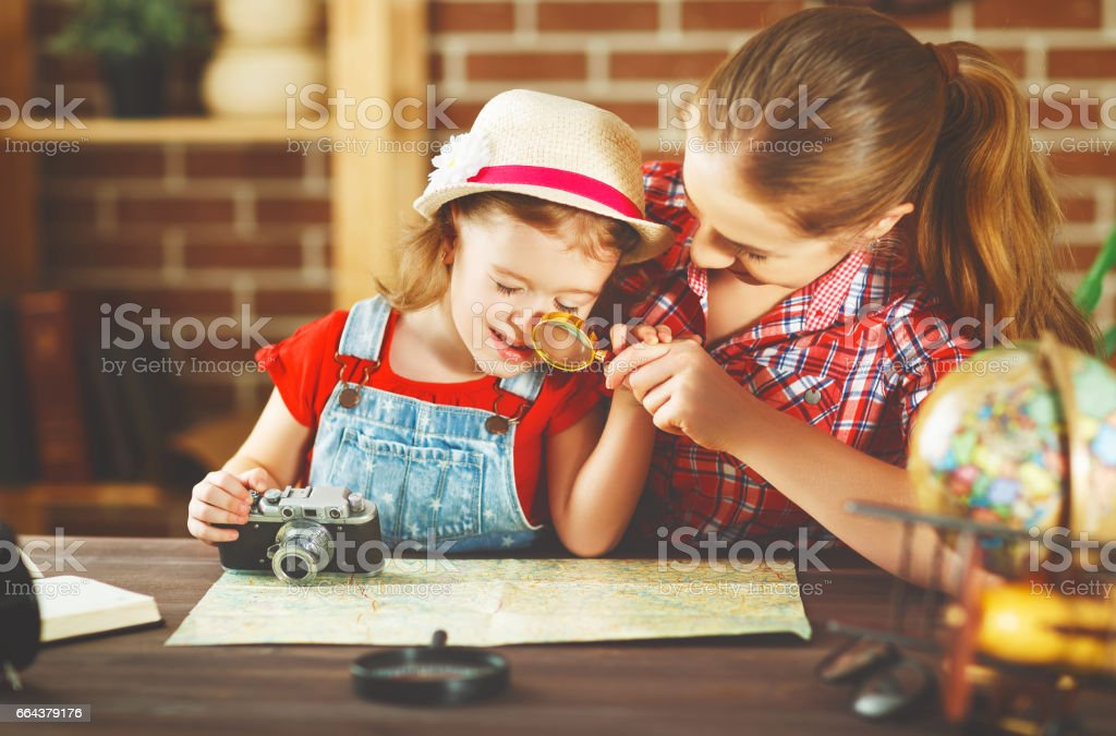 happy family mother and child going on a trip, make up route map stock photo