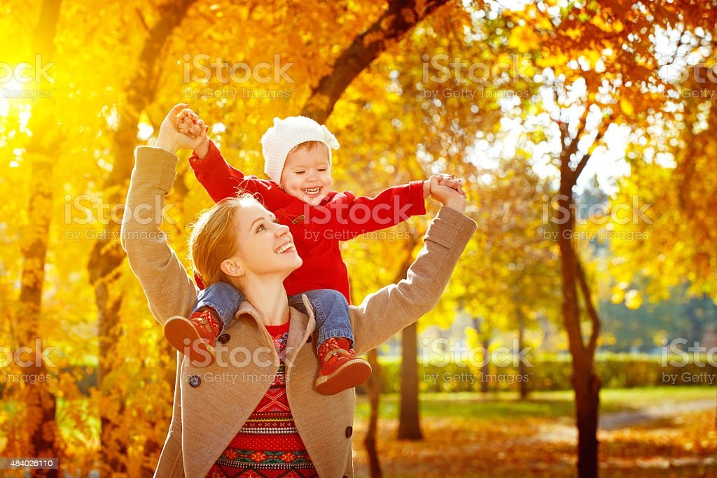 happy family: mother and child little daughter play cuddling on stock photo