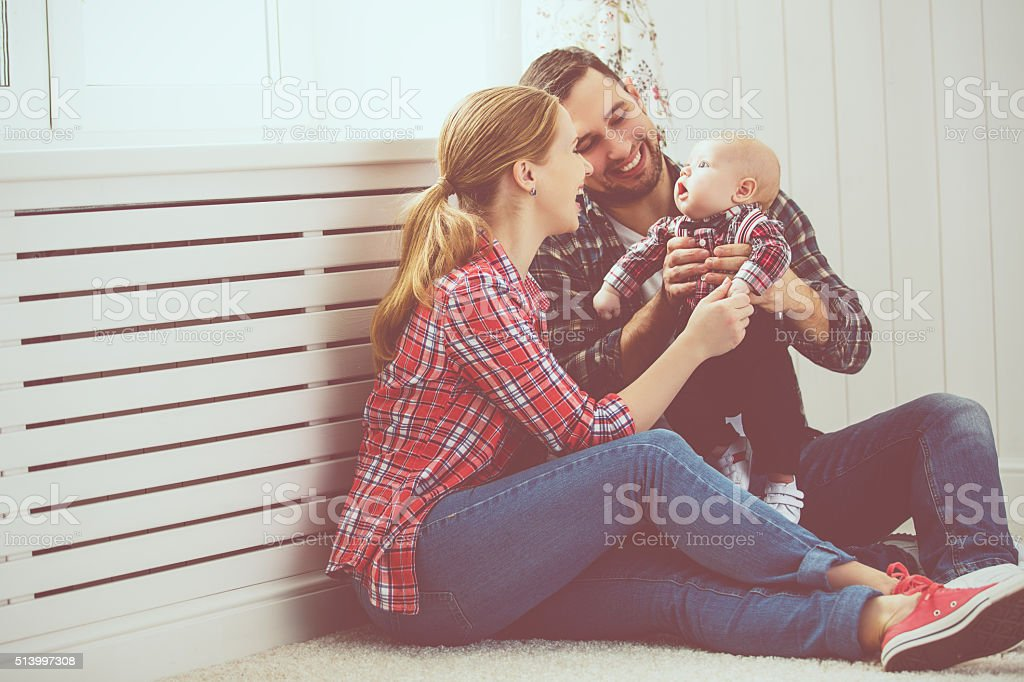 happy family mother and father playing with a baby stock photo