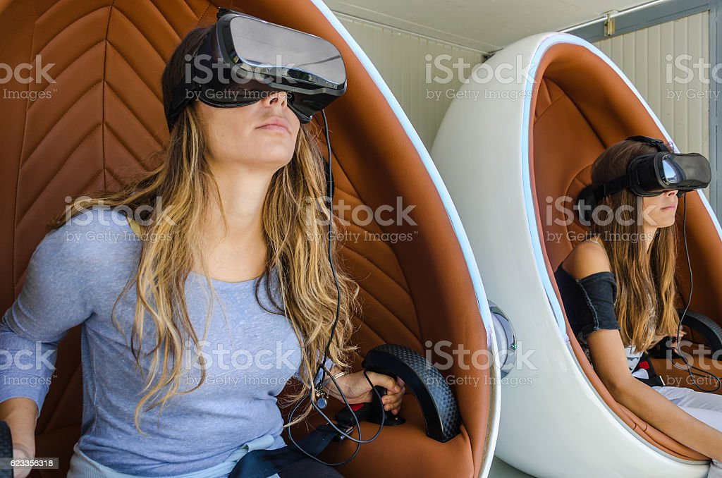 Happy family! Mother and her daughter using virtual reality glas stock photo
