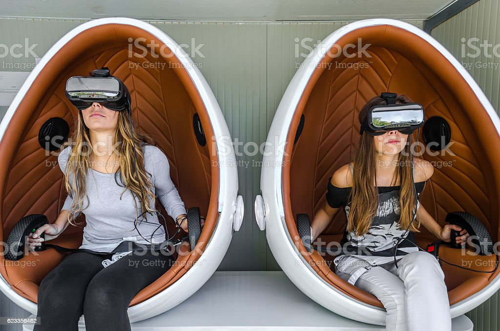 Happy family. Mother and her daughter using virtual reality glas stock photo