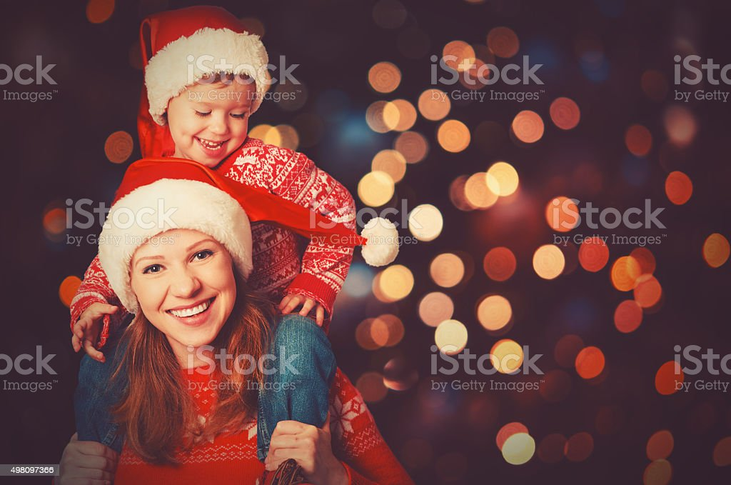 happy family mother and little child playing in Christmas stock photo